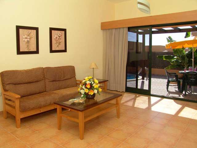 Lounge leading to patio and pool - Villas del Sol, Corralejo, Fuerteventura