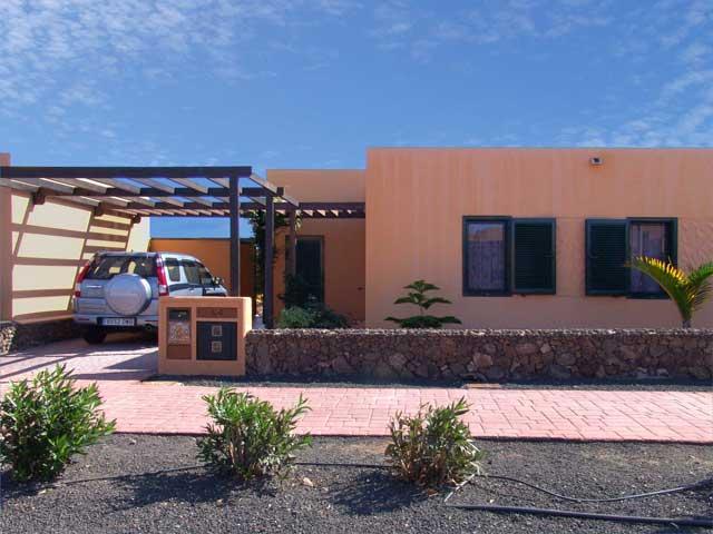 View of villa from road showing parking - Villas del Sol, Corralejo, Fuerteventura