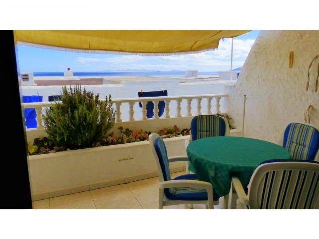 Dining area in the terrace - Nice Seaview Apartment, Puerto del Carmen, Lanzarote