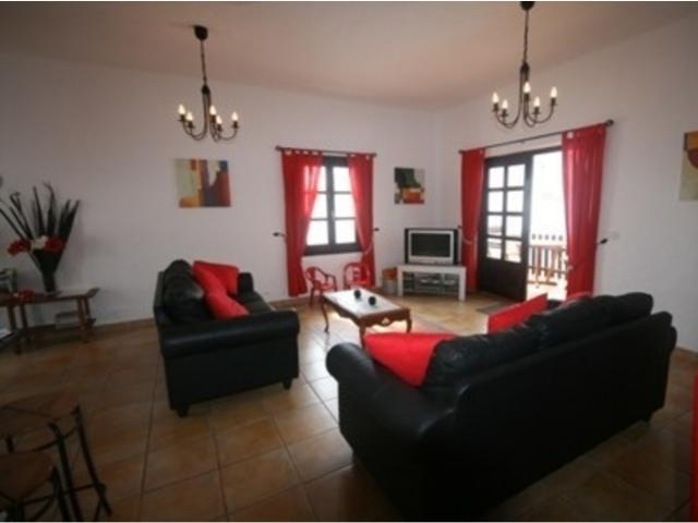 Lounge showing french doors to pool - 3 bedroom villa apartment, Punta Mujeres, Lanzarote